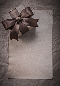 Giftbox with bow sheet of wrapping paper