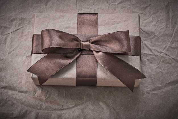 Giftbox with present tape on wrapping paper