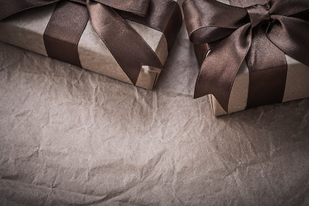 Giftboxes with bow on wrapping paper celebrations concept