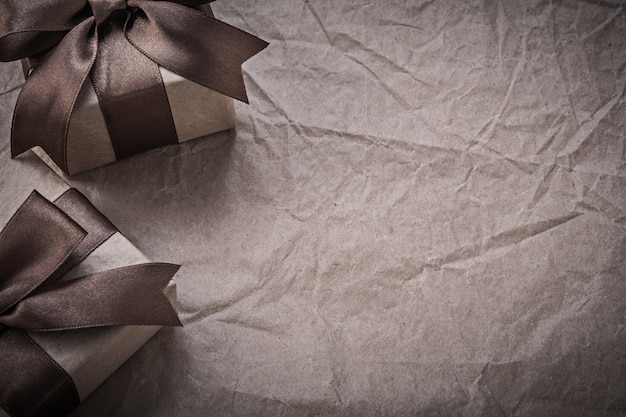 Giftboxes with tied bow on wrapping paper celebrations concept