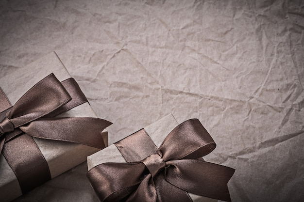 Giftboxes with tied ribbon on wrapping paper celebrations concept