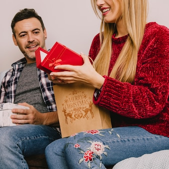 Gifting concept with woman opening box
