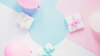 Gifts and balloons on colorful background