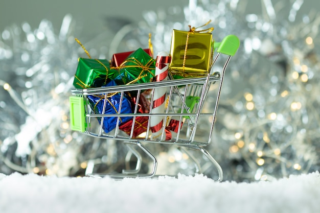 Gifts box in the cart on light bokeh background,