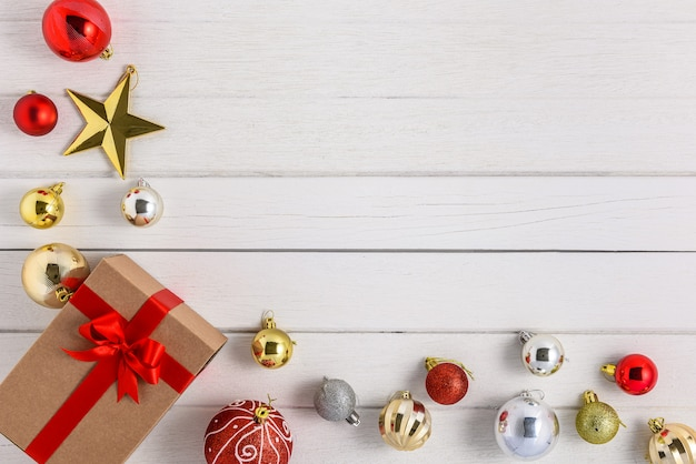 Gifts boxes with festive ribbons and christmas ornament on white wood