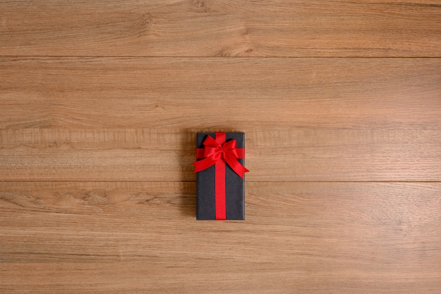 Gifts boxes with festive ribbons on wooden background