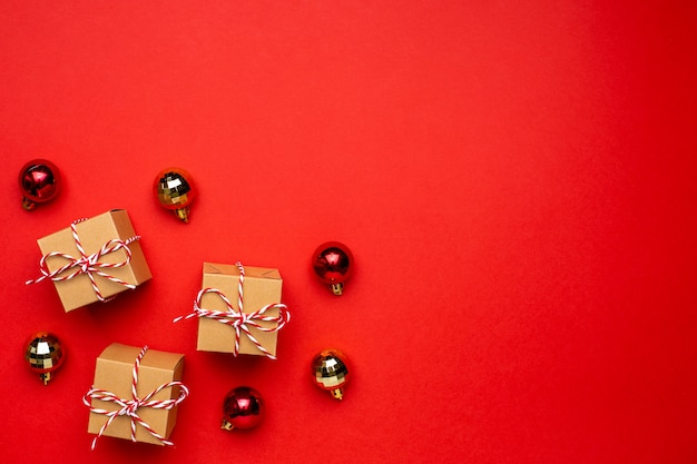 Gifts and christmas decor on a colored red background.
