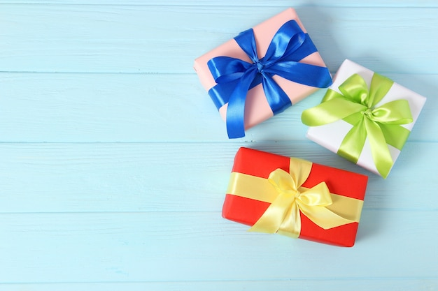 Gifts on a colored background top view holiday giving presents birthday