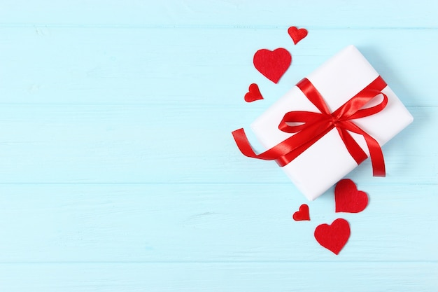 Gifts and hearts on a colored background top view love