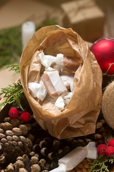 Gifts and homemade toffee in christmas decorations.
