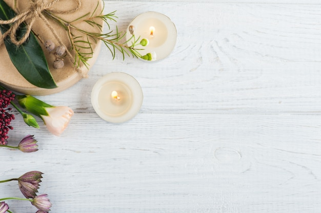 Gifts and lit candles, flower