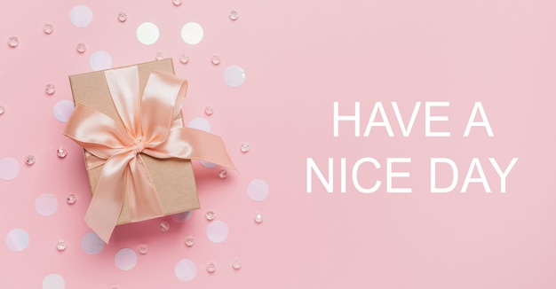 Gifts on pink background, love and valentine concept with text have a nice day