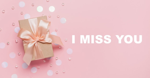 Gifts on pink background, love and valentine concept with text i miss you