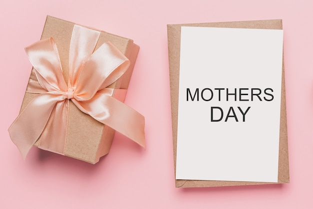 Gifts with note letter on isolated pink background, love and valentine concept with text mothers day