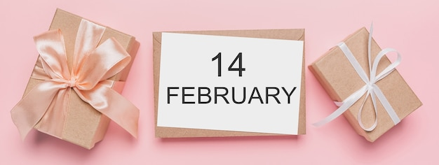 Gifts with note letter on isolated pink background, love and valentine concept with text14 february