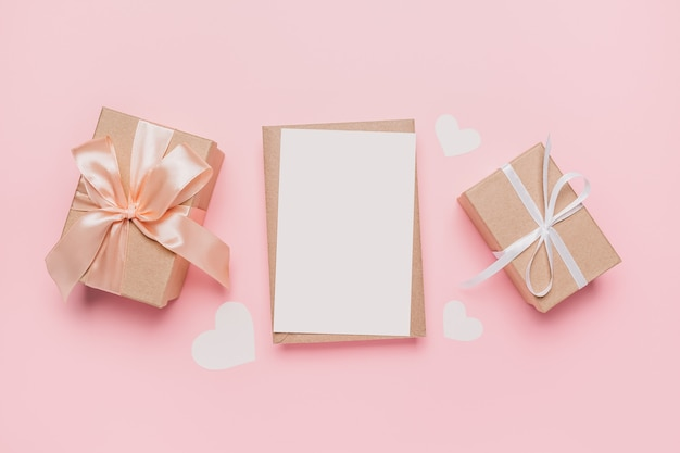 Gifts with note letter on isolated pink background, love and valentine concept