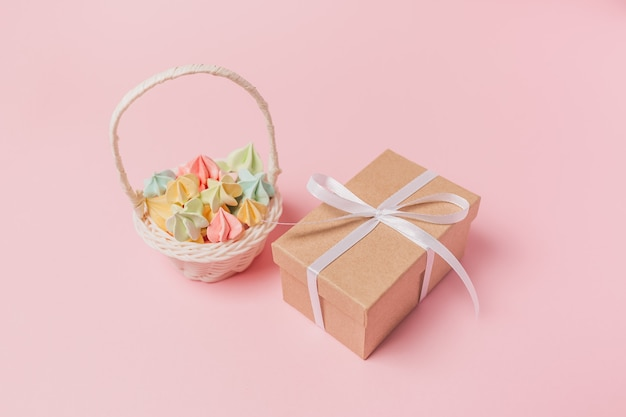 Gifts with sweets on isolated pink surface, love and valentine concept