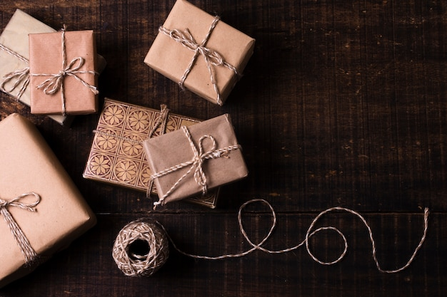 Gifts wrapped in paper with wooden background