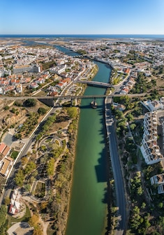 The gilao river and bridges in the city of tavira.