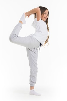 Gild doing stretching exercise isolated on white surface