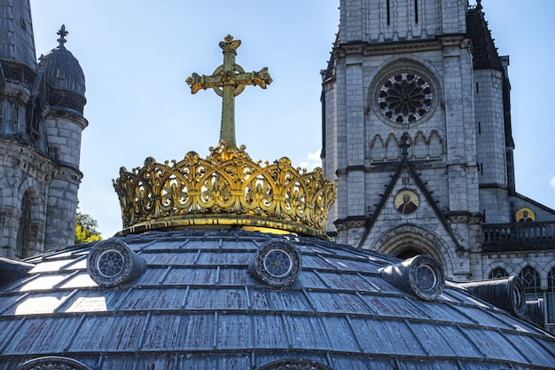 The gilded crown ad cross in lourdes