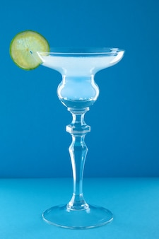 Gin tonic cocktail on blue wall