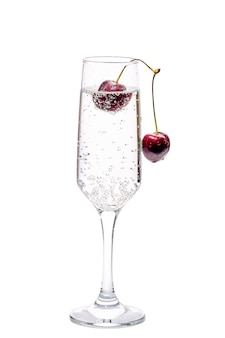 Gin and tonic with cherry isolated on white