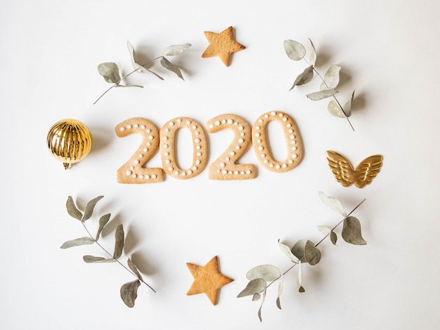 Ginger biscuits of the form of numbers and 2020 new year ginger cookies and xmas decoration fram