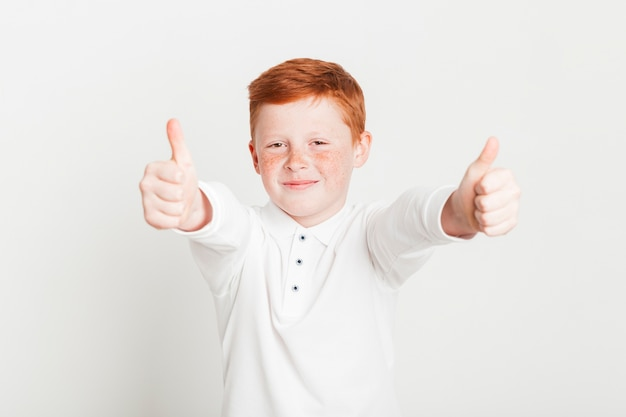 Ginger boy doing thumbs up