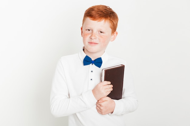 Ginger boy holding a book