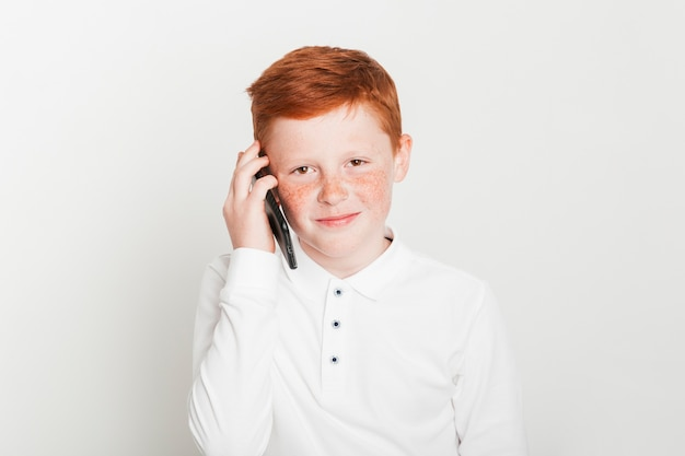 Ginger boy making phone call