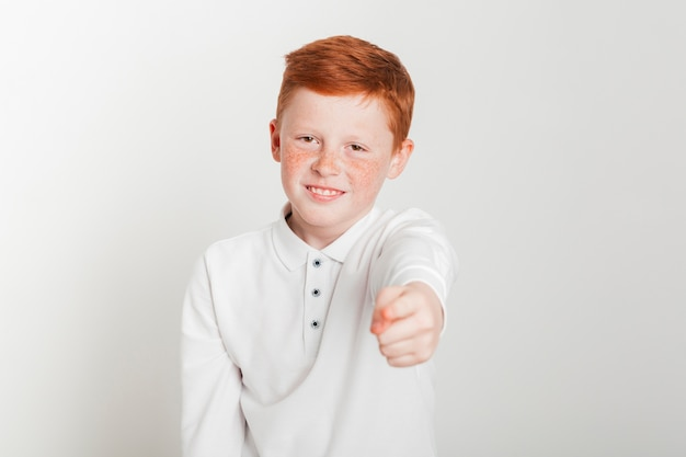 Ginger boy pointing towards you