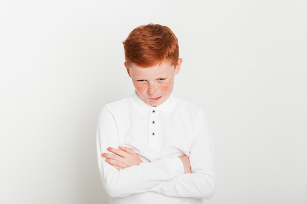 Ginger boy with arms crossed