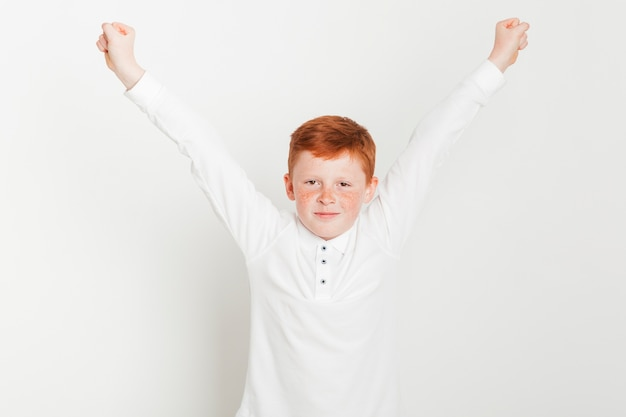 Ginger boy with arms raised