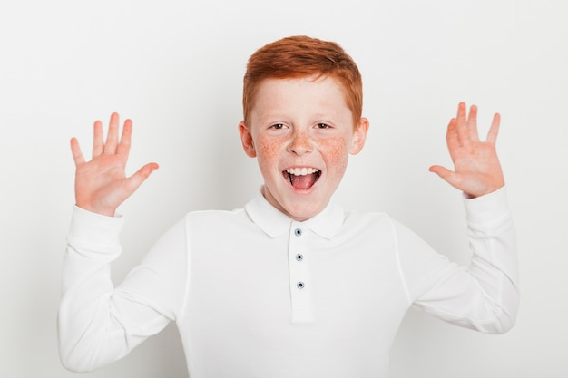 Ginger boy with cheerful expression