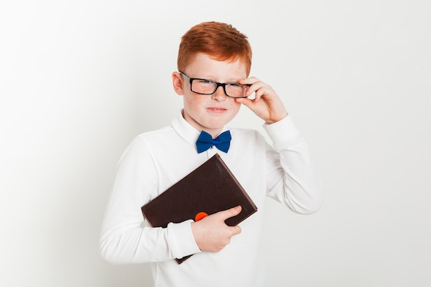 Ginger boy with glasses and book