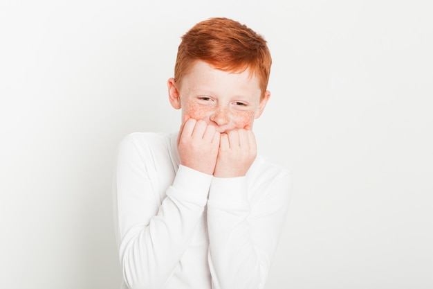 Ginger boy with laughing expression