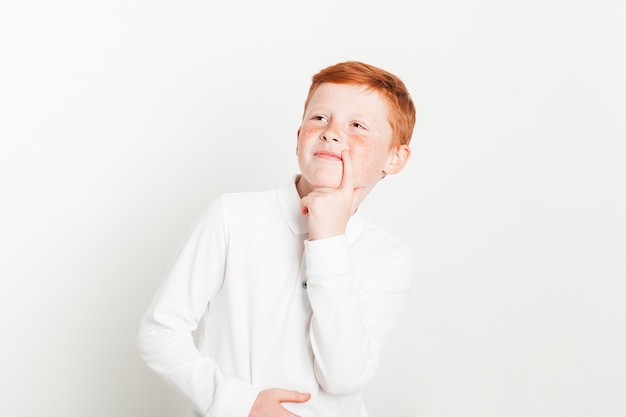 Ginger boy with thinking expression