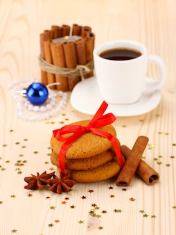 Ginger cookies, milk and christmas decoration on light surface