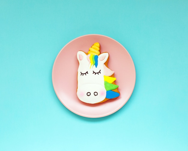 Ginger cookies in the shape of a unicorn on geometric pastel paper