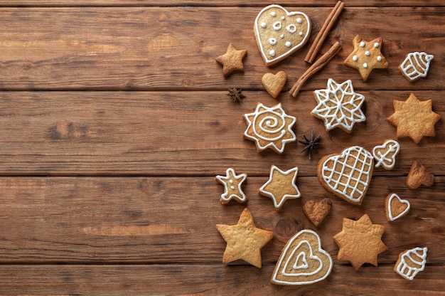 Ginger cookies with icing on a wooden background.