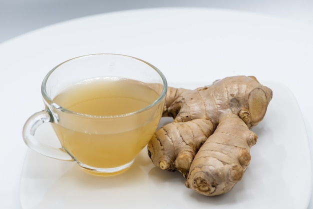 Ginger juice fresh in a glass cup on white background for healthy.