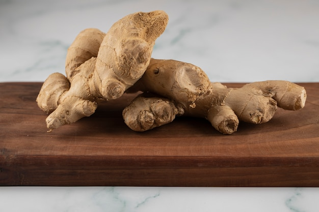 Ginger plants on a wooden board.