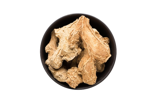 Ginger root in clay bowl isolated on white background. seasoning or spice top view
