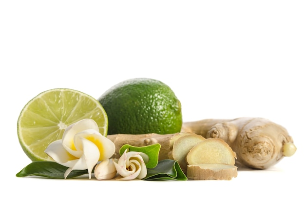 Ginger root and lime whole and half with flowers and leaves isolated
