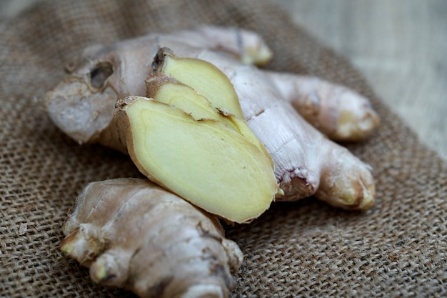 Ginger root sliced on wooden table