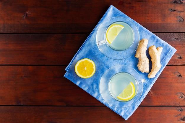 Ginger tea with lemon on blue napkin