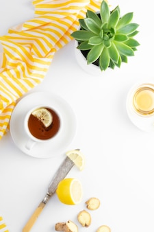 Ginger tea with lemon honey hot autumn, winter drink white  with copyspace flat lay.