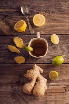 Ginger tea with lime in a white cup