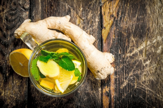 Ginger tea with mint and lemon. on wooden background.